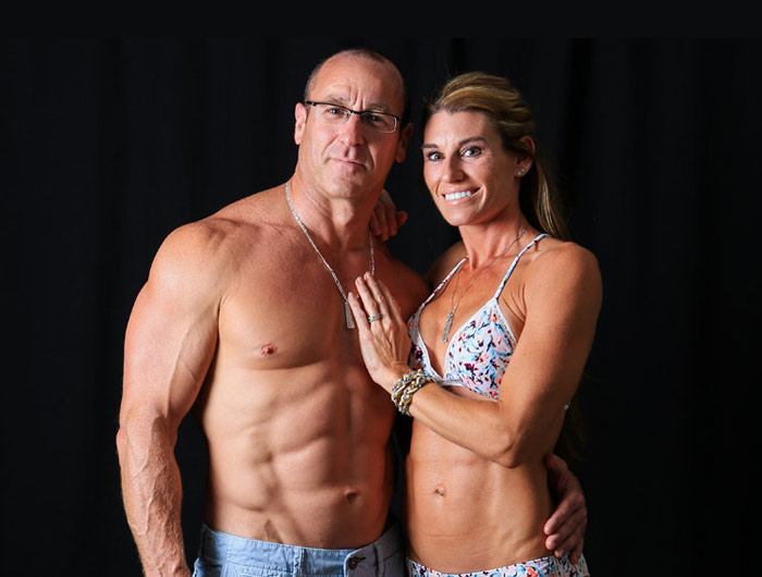Dr. Osborn shirtless, and Melissa Hankins in a bikini