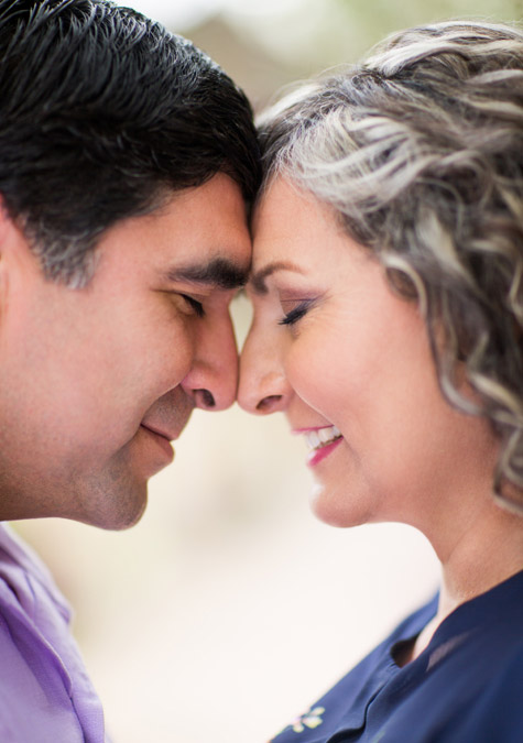 older couple in an intimate moment touching foreheads with each other